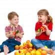 Stock Photo: Girl and boy with fruit and vegetables