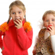 Girls bite apples on white background — Stock Photo