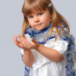 Stock Photo: Girl in New Year's dress stretches handles