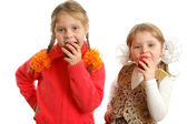 Girls bite apples on white background — Photo