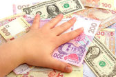 Female hand on monetary denominations — Stock Photo