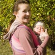 Mama with baby in sling — Foto Stock
