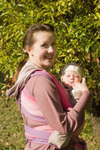 Mama with baby in sling — Stock Photo