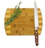 Rosemary on chopping board — Stock Photo