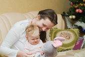 Mum playing with her dauther and hare — Stock Photo