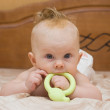 Stock Photo: Baby gnaw green latex teether