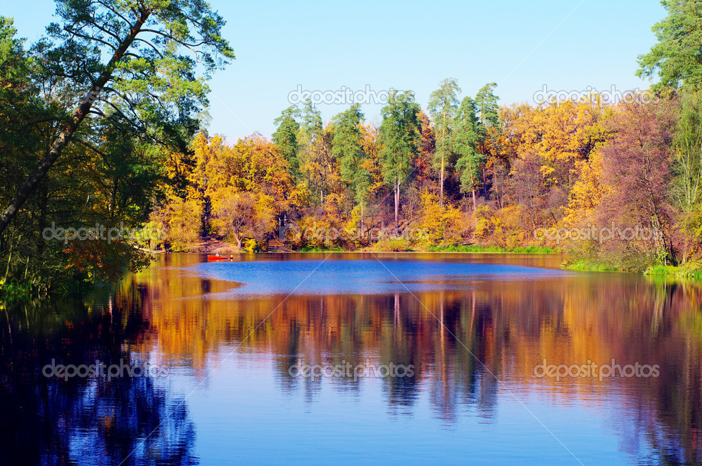 Picturesque autumn landscape of river and boat  Stock Photo #4133174