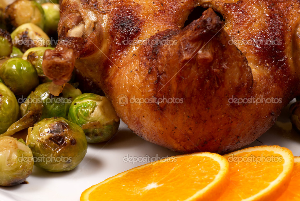 Duck à l´orange seved with brussels sprouts — Stock Photo #4052759