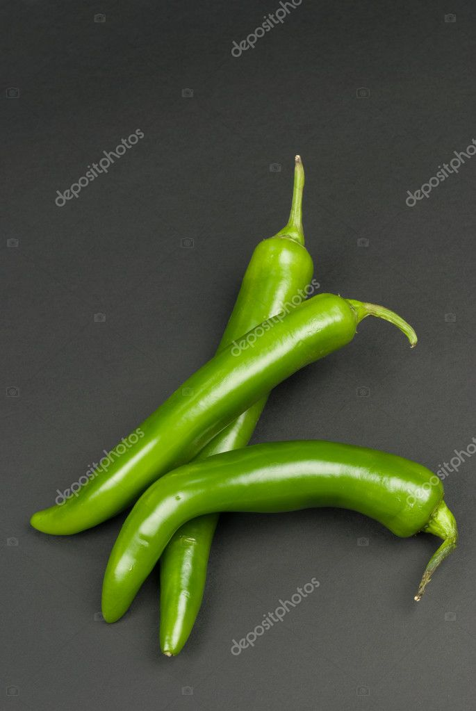 Arrangement of three fresh spicy green chili peppers — Stock Photo #4677454