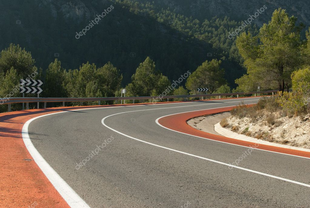 Scenic bent mountain road with bicycle lanes — Stock Photo #4974718