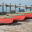 Stock Photo: Canoes on Shore