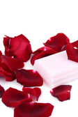 Pink soap with rose petals — Stock Photo