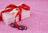 Soap with roses and stones — Stock Photo