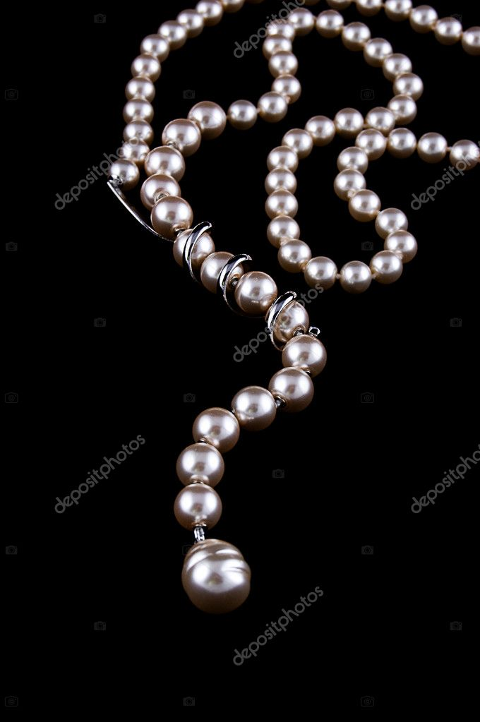 White pearls necklace on black background — Stock Photo #4005480