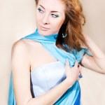 Elegant woman in blue dress — Stock Photo