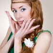 Woman in green dress touching her face - Lizenzfreies Foto