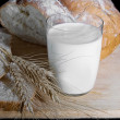 Glass of milk, wheat and bread - Stock fotografie
