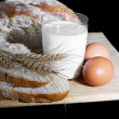 Glass of milk, wheat, eggs and bread - Photo
