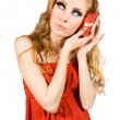 Woman in red dress holding gift-box — ストック写真