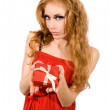 Woman in red dress holding gift-box — Stock Photo