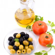 Olive oil, tomatoes and greens - Stock Photo