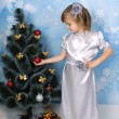 Beautiful girl in a silver dress near tree — Stock Photo