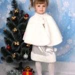 Beautiful girl in a fur cloak around the Christmas Tree — Stock Photo #4338287