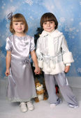 Cute girl and a boy dressed in the clothes on a blue background — Stok fotoğraf