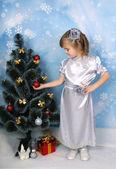 Beautiful girl in a silver dress near tree — Stock Photo