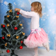 Cute girl in a lush tree skirt dresses — Stock Photo