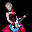Beautiful blonde in black and pink dress with an electric guitar — Stock Photo