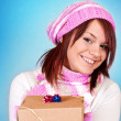 Girl giving a gift — Stock Photo