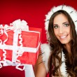 Beautiful woman holding xmas present — Stock Photo