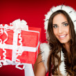 Beautiful woman holding xmas present - Stock Photo