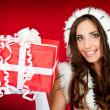 Beautiful woman holding xmas present — Stock Photo