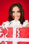 Woman holding big Christmas present — Stockfoto