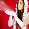 Santa woman blowing snow — Stock Photo