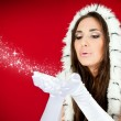 Santa woman blowing snow from her hands — Stock Photo
