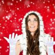 Woman in santa clothes standing in the snow — Stock Photo #4080222