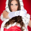 Sexy woman pointing in santa costume — Stock Photo