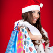 Santa's helper in shopping — Stock Photo