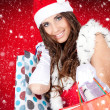 Sexy santa woman  with shopping bags — Stock Photo