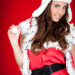 Young woman in santa costume posing — Stock Photo #4080791