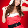 Attractive woman in santa costume posing — Stock Photo #4080842