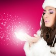 Winter woman blowing snowflakes — Stock Photo