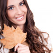 Close-up of woman holding leaf — Stock Photo