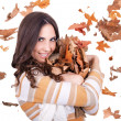 Happy autumn woman with falling leaves — Stock fotografie