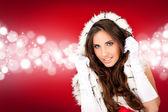 Sexy santa op glanzende achtergrond — Stockfoto