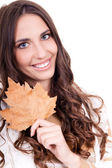 Close-up of woman holding leaf — Стоковое фото