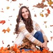 Attractive autumn woman and falling leaves — Stock Photo